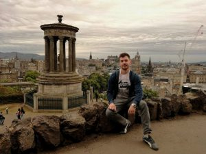 A boy poses for a picture at Calton Hill in Edinburgh